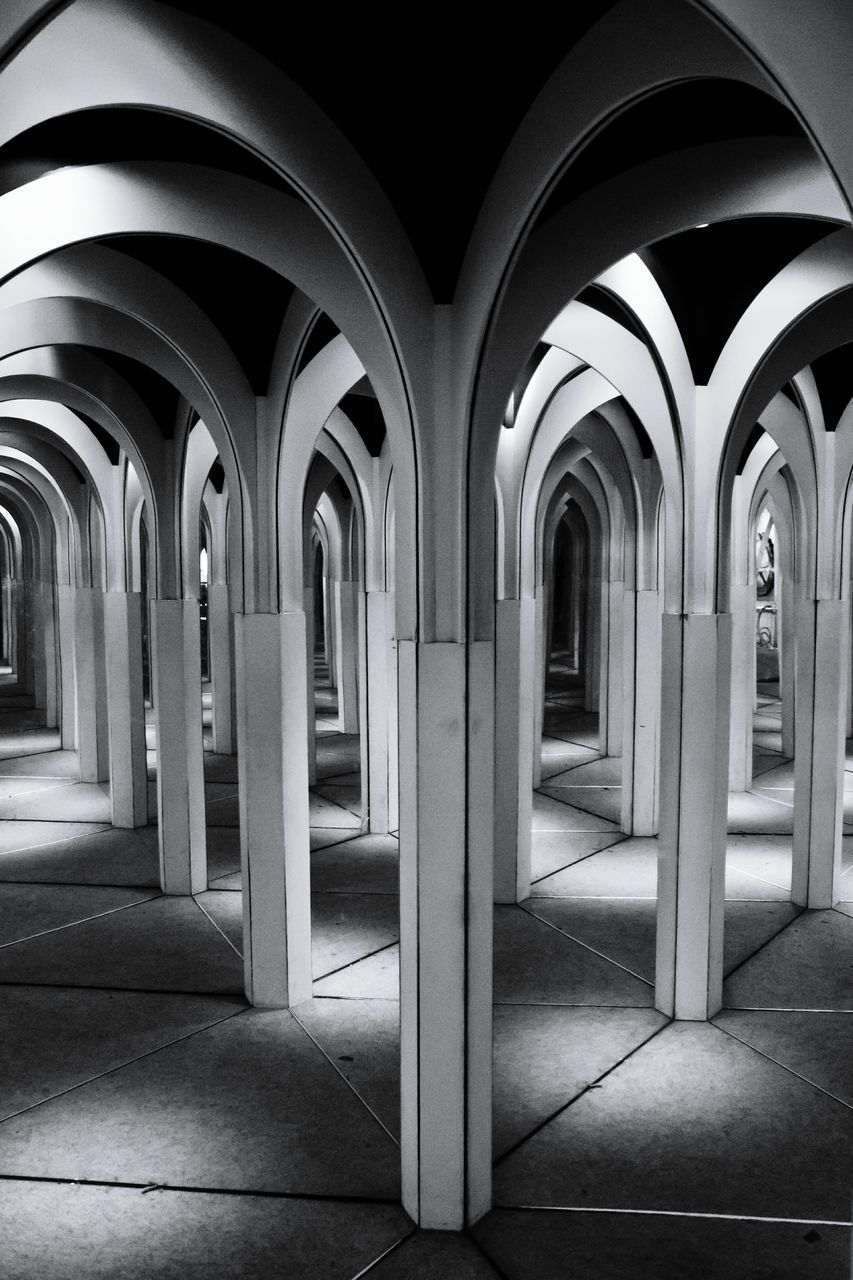 Reflection Of Colonnade In Mirror
