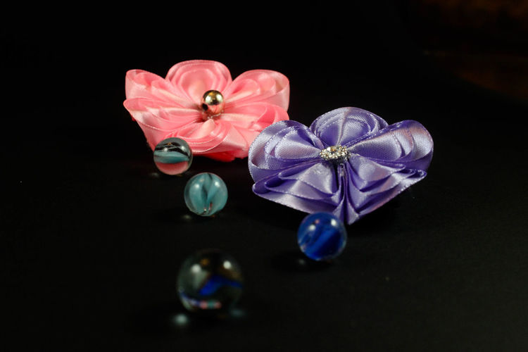 Beauty In Nature Black Background Close-up Diamond - Gemstone Elégance Flower Flower Head Flowering Plant Freshness Indoors  Jewelry Luxury Multi Colored No People Pink Color Precious Gem Reflection Still Life Studio Shot Two Objects Wealth