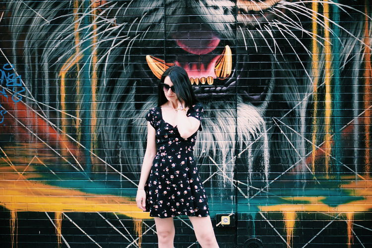 burning bright Manhattan NYC Street Art Graffiti Mural Art Beauty Youth Culture One Young Woman Only Tiger Wall Brick Wall Black City Life Urban Scene Fashion Street Photography Street Fashion Young Women Full Length Standing Three Quarter Length Mini Dress Voluptuous Posing Charming Sleeveless  Mini Skirt Complexion My Best Photo International Women's Day 2019