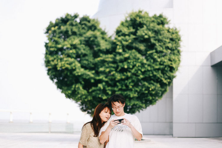 Young Couple In Front Of Tree