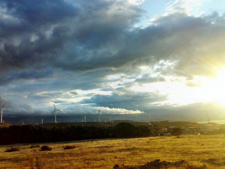 Iran,gilan,rudbar First Eyeem Photo Cloud Covered Sun Cloudy Sky Turbines Turbine In The Background