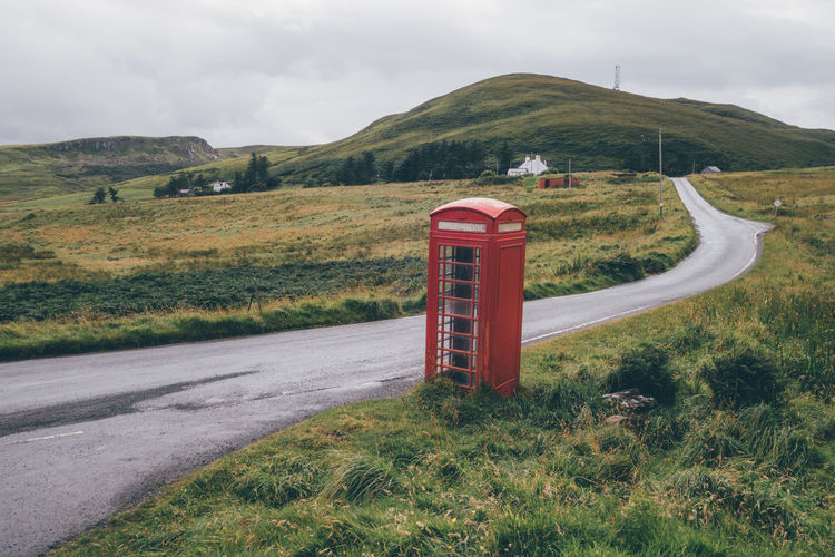 Telephone Booth On Field By Road