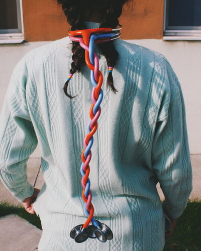 Rear View Of Woman With Braided Stethoscopes Standing Outdoors