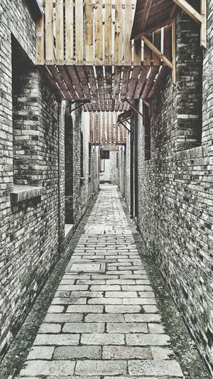 Narrow alley in front of building