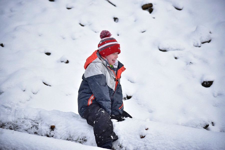 Snow Winter Cold Temperature Weather Warm Clothing Lifestyles Real People Leisure Activity Vacations Hiking Childhood One Person Nature Adventure Tobogganing Outdoors Playing Day Beauty In Nature Mammal Snow Covered Snow ❄ Outside Photography Winter Play