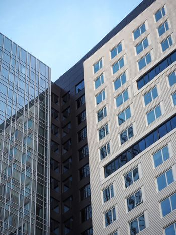 Abstract photo of two modern buildings Abstract America USA Windows Pastel Reflection Glass Golden Ratio Urban Architecture Leading Lines Lines Massachusetts Boston Colour Your Horizn Building Exterior Architecture Built Structure Modern Low Angle View Skyscraper Blue City No People Day Outdoors Clear Sky The Architect - 2018 EyeEm Awards