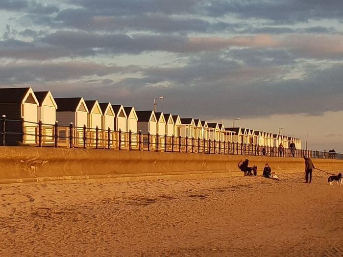 beach huts Beachphotography Beach Huts Dramatic Sky Holiday EyeEm Best Shots Eye4photography  Eyeemphotography Sand Pets Desert Sky Animal Themes Shore