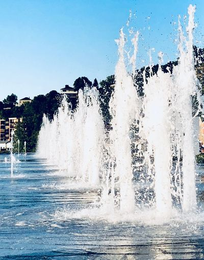 Water Splashing Motion Nature Day Waterfront No People Sea Outdoors Power Sky Fountain Power In Nature Wave Clear Sky Spraying Beauty In Nature Sport Tree Breaking