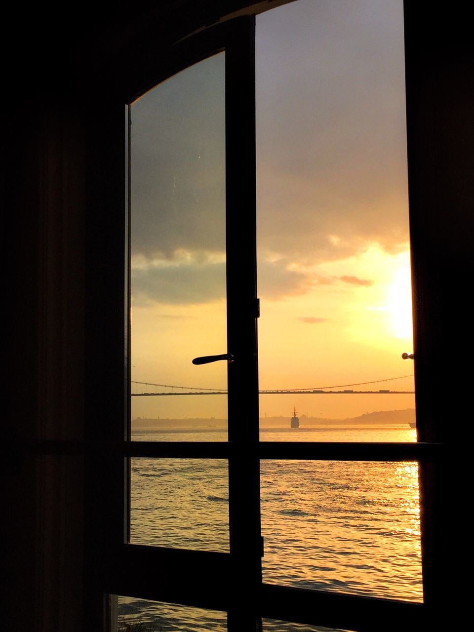 sunset, sea, orange color, water, silhouette, nature, scenics, tranquil scene, sky, beauty in nature, tranquility, window, horizon over water, indoors, no people, close-up, day