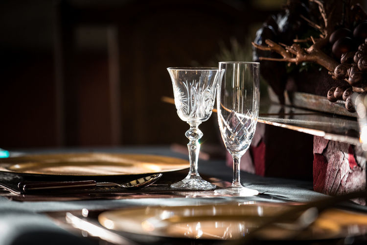 Close-up of glasses on dining table