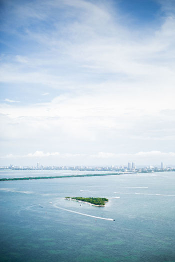Aerial view of biscayne bay against cloudy sky