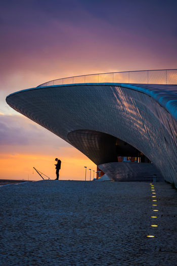 Architecture Lisbon - Portugal MAAT Museum Maat, Portugal, Belem Sunset Silhouettes Sunset_collection Architecture Beach Beauty In Nature Built Structure Dusk Leisure Activity Lifestyles Maat - Museum Men Nature One Person Orange Color Scenics - Nature Sea Silhouette Sky Sunset Transportation Water Adventures In The City The Architect - 2018 EyeEm Awards #urbanana: The Urban Playground Capture Tomorrow