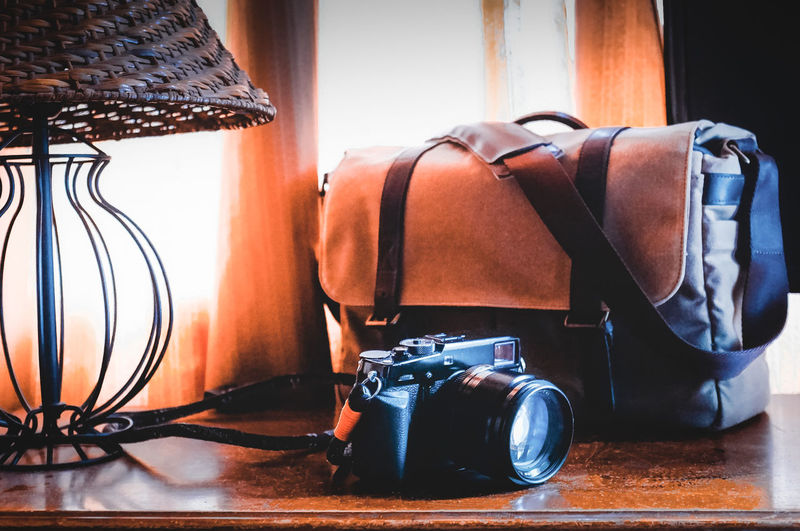 Camera Bag Nice Cameras ONA Bags X-PRO2 Bag Camera Close-up Connection Digital Camera Electric Lamp Equipment Focus On Foreground Indoors  No People Photographic Equipment Photography Themes Retro Styled Still Life Table Technology The Still Life Photographer - 2018 EyeEm Awards