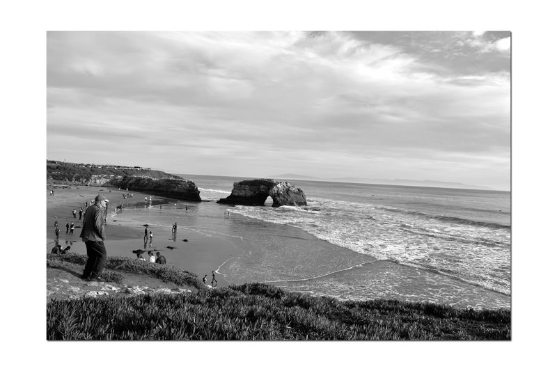 Natural Bridges State Beach 6 Santa Cruz, Ca. Wave-carved Sea Arch 65 Acre Park Beach 3 Naturally Occurring Arches Of A Large Cliff Water Power Eroded The Mudstone Water Sand Only The Middle Of The 3 Original Arches Remains Monochrome Photograhy Monochrome Man On Cliff Overlooking Beach Waves Scenics People On The Beach Horizon Over Water Black & White Black And White Photography Black And White Black And White Collection  Landscape_Collection Landscape_photography Nature Beauty In Nature Nature_collection