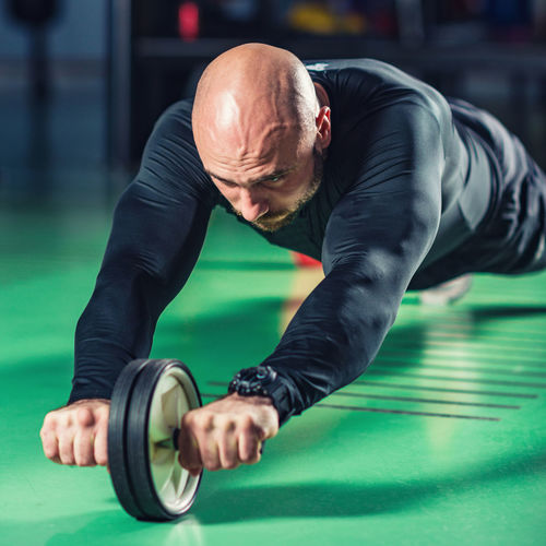 Man Exercising At Gym