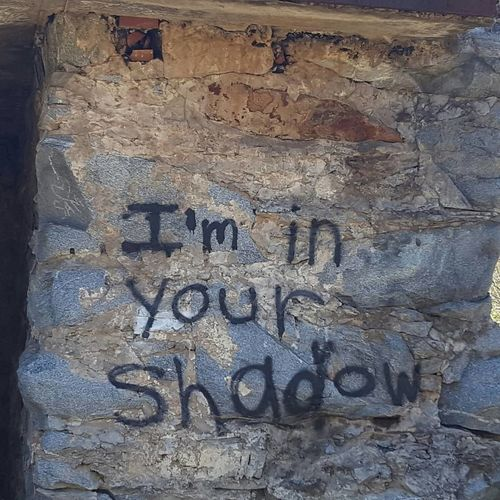 I'm in your shadow No People Close-up Text Day Outdoors Graffiti Exploring Fall From Grace Building Exterior Abandoned Places Long Gone  From Years Past Historical Monuments No Filter, No Edit, Just Photography Im In Your Shadow Love Where You Live Textured  Backgrounds