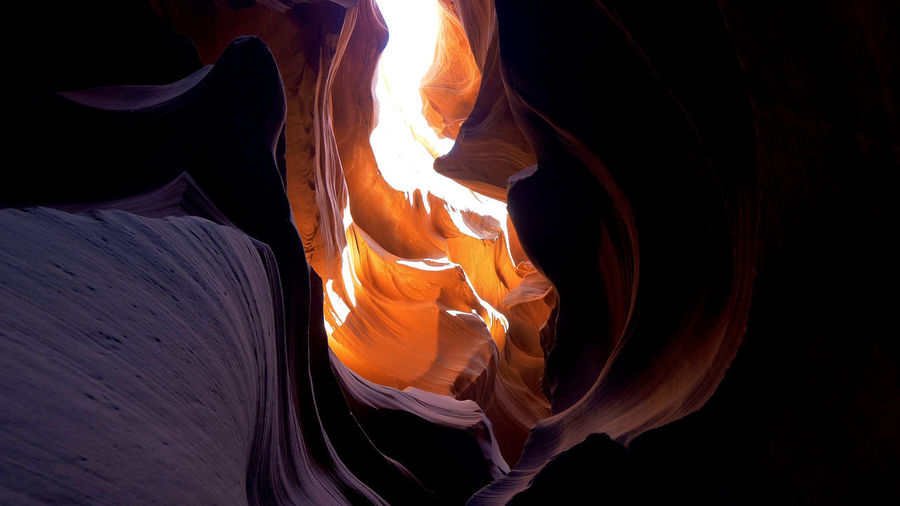 Close-up of fire on rock at night