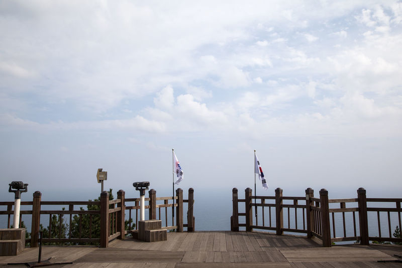 Ulleungdo is the most mysterious island. It is located at East Sea of South Korea. I have been there for 13 days for photo travel. Calm Cloud Cloud - Sky Day Dokdo Observatory Empty Flag Full Length In A Row Island Jetty Long Narrow National Flag Ocean Pier Railing Relaxation Sea Sky Surface Level Tranquil Scene Tranquility Ulleungdo Water