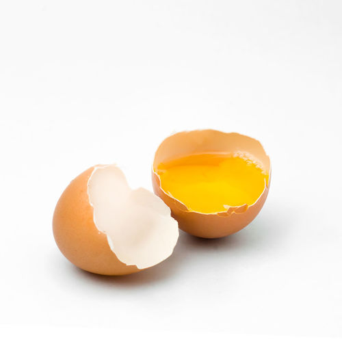 Broken Close-up Copy Space Cracked Cut Out Egg Egg Yolk Eggshell Food Food And Drink Freshness Healthy Eating Indoors  No People Raw Food Shell Studio Shot Wellbeing White Background Yellow