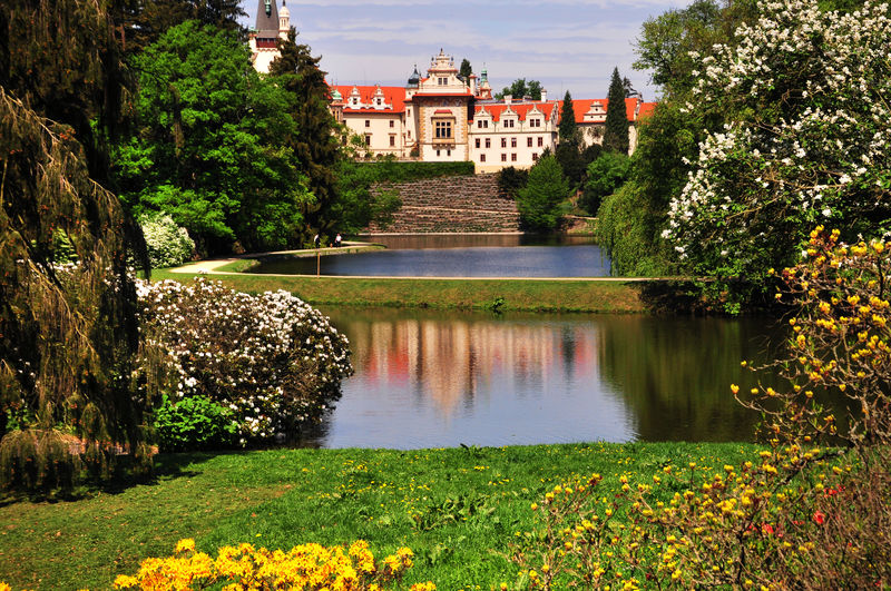 Czech Pruhonice park landscape with Pruhonice castle reflecting in the lake in blooming spring time. Prague. The park is listed as a UNESCO World Heritage Site Czech Castle Czech Republic Europe European Castle Prague Pruhonice Castle Architecture Beauty In Nature Building Built Structure Day Flower Green Color Lake Nature No People Outdoors Průhonice Průhonický Park Spring Time Tree Water