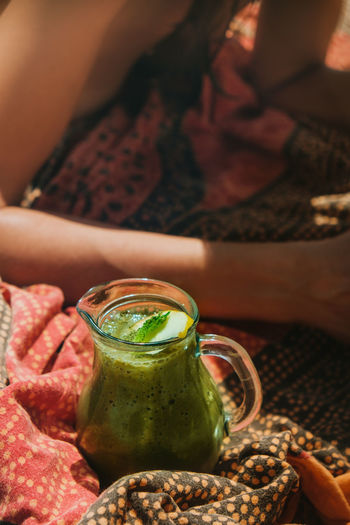 Female hand holding an exotic colorful smoothie on the beach in a warm summer day Beach Life Summer Summer Views Chilling Sandy Beach Sunny Day Woman Real People Human Hand Human Body Part Freshness Smoothie Vibrant Color Drinks Cocktail Healthy Lifestyle Healthy Food Vegan Vegan Food Relaxing Relaxing Moments Relax