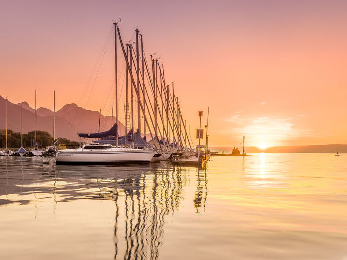 Harbor Sunset Sunset_collection Beauty In Nature Harbor No People Outdoors Reflection Sailboat Sea Sun Sunlight Sunset Sunsets Tranquil Scene Tranquility Transportation Water Waterfront