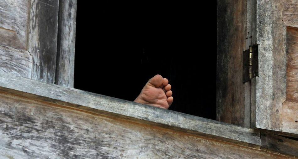 Small feet on the window Body Part Feet Leg window House wood Creativity Toraja Utara INDONESIA snapshot
