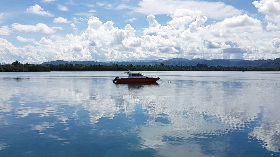 A boat on the beautiful reflecting sea Boat Mode Of Transport Scenics Sky Cloud Nature Beauty In Nature Samsungphotography Indonesia_photography Ternate Island, Molucca Parking