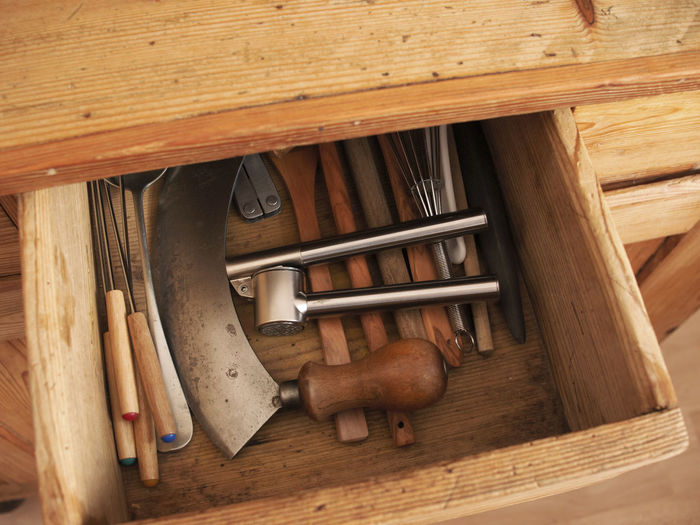 High angle view of kitchen utensils in drawer