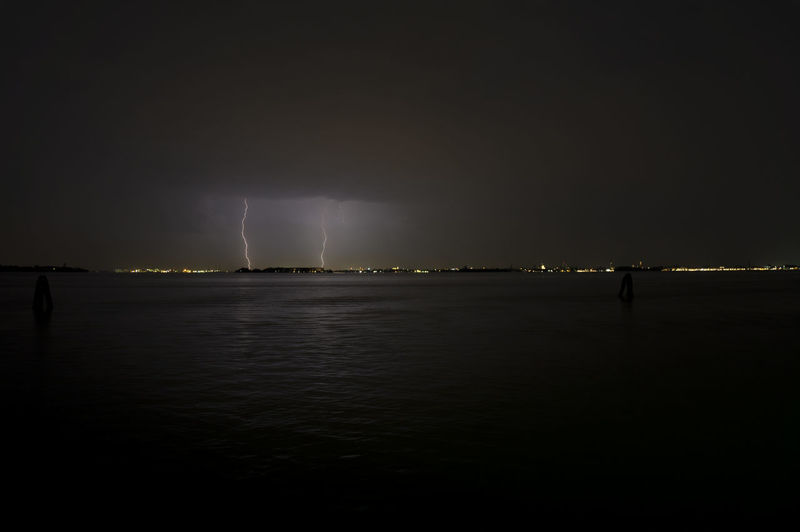 Scenic view of sea at night during thunderstorm