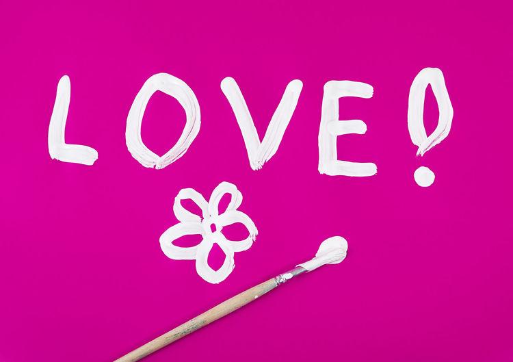 Close-up of pink text