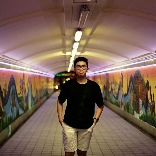 Graffiti Tunnel One Man Only Looking At Camera Adult One Person Only Men Portrait People Adults Only Street Art Front View Men City Casual Clothing One Young Man Only Multi Colored Young Adult Beard City Outdoors Canonphotography Full Frame Vacations Subway Station