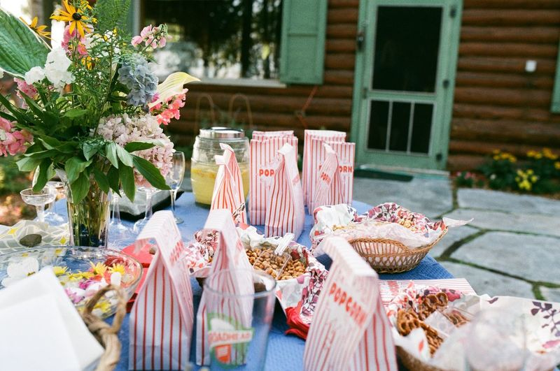 Popcorn packets on table against house