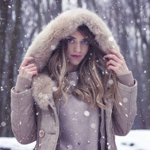 Portrait Of Young Woman Wearing Warm Clothing During Winter