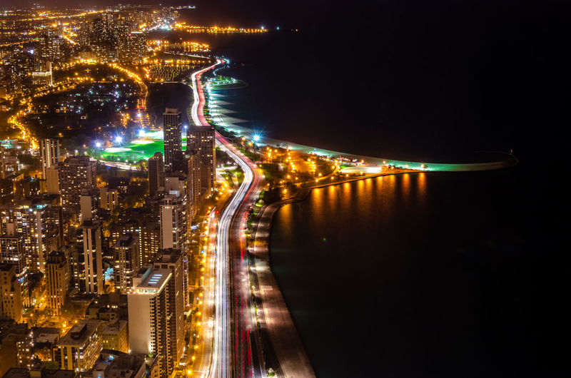 Aerial View Of Illuminated City By River At Night