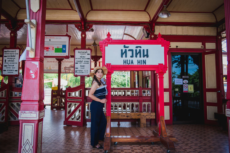 Woman standing at entrance of store