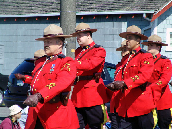 Royal Canadian Mounted Police in July 1st parade in Richmond B.C. Canada. Mature Adult Uniform Ceremony Day Outdoors Steveston Richmond BC Parade july 1st