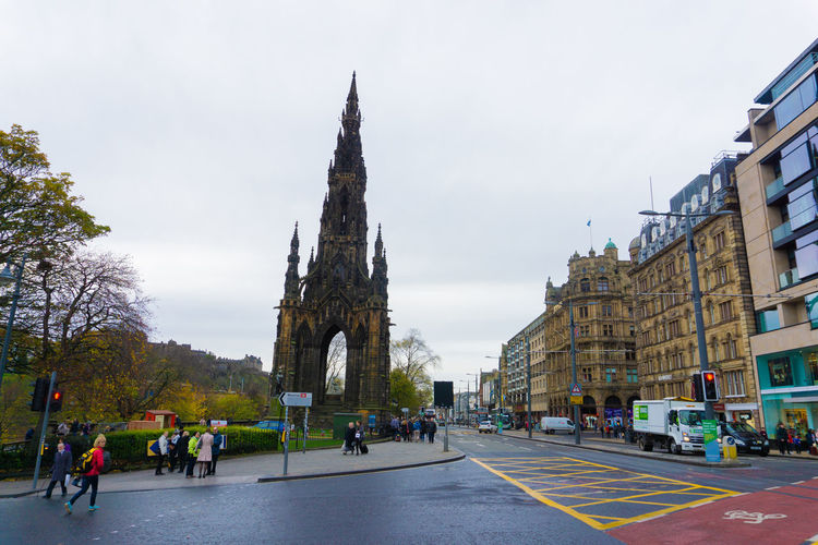 Edinburgh, Scotland, United Kingdom - November 7, 2017: Street view with people crossing the road in Edinburgh City Cars Car Walk Sign Transportation Road Street Traffic Light  Crossroads Europe Uk Scotland Editorial  Edinburgh Architecture Travel Landmark Tourism City Famous Urban Building People Gothic Attraction Old Heritage Cityscape Historic Tower Cathedral Medieval British Church Town Historical History