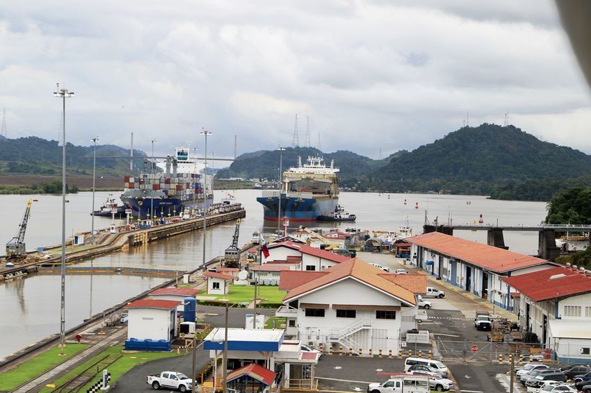 Miraflores Locks Panama Canal Architecture Building Exterior Built Structure Cargo City Cloud - Sky Day Harbor High Angle View Lock Mode Of Transport Mountain Nature Nautical Vessel No People Outdoors Ship Traffic Sky Transportation Travel Destinations Water