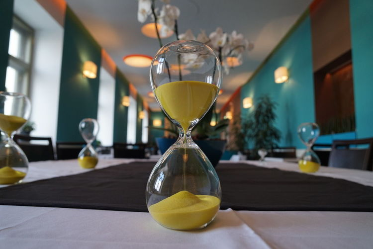 Close-up of hourglass on table at restaurant
