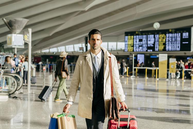 Men walking in airport
