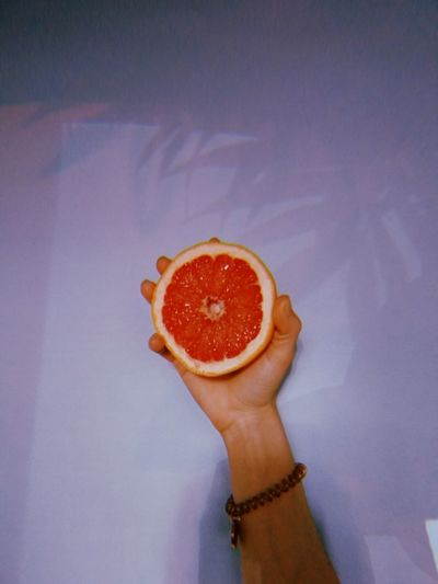 High angle view of woman holding orange