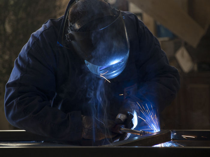 Close-Up Of Man Wearing Welding Mask