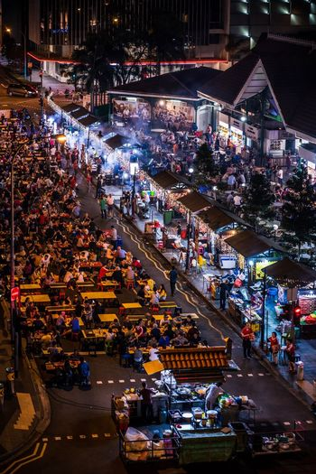 High angle view of people in street market at night