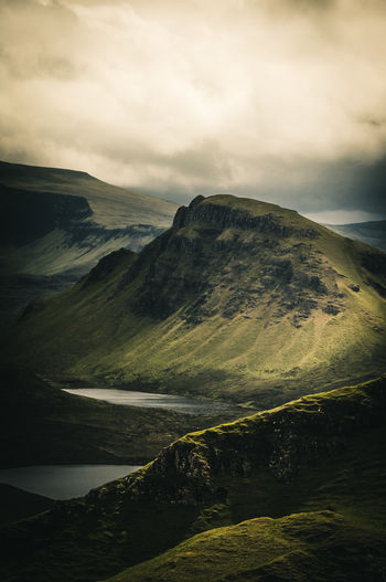 the quiaraing. Awe Beauty In Nature Beauty In Nature Cloudy Sky Cultures Day Green Landscape Grey Sky Isle Of Skye Scotland Lakes  Landscape Mountain Mountain Range No People Outdoors Panorama View Quiaraing Rocky Landscape Scenics Sunlight And Shadow Tranquil Scene Travel Destinations Travel Photography