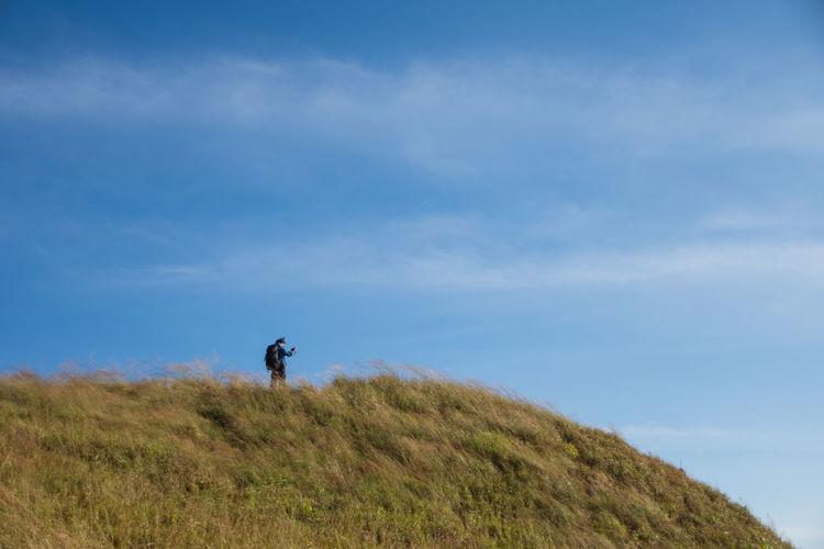Man on field against sky