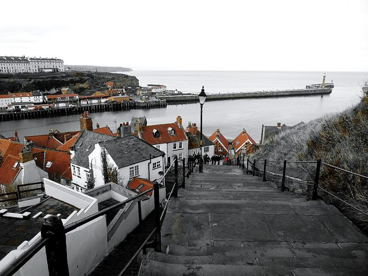 What goes up must also come down! 199 steps lead from Whitby abbey back down to the town and harbour below .... Sea Water Horizon Over Water Steps Harbor Outdoors Nature Lamp Post Houses Clay Roof Tiles Coloursplash Terracotta Colour Whitby North Sea Coast Cast Iron Railing Jetty Sky Yorkshire Up High Looking Down Steep Cliff Distant View The Architect - 2017 EyeEm Awards