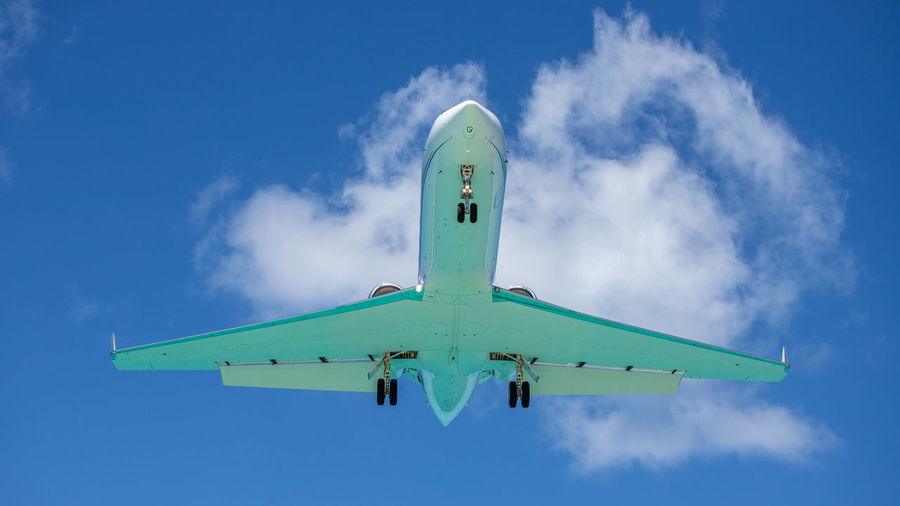 Air Vehicle Airplane Sky Transportation Flying Mode Of Transportation Low Angle View Cloud - Sky Blue Travel Nature on the move Day No People Motion Outdoors Mid-air Plane Green Color Commercial Airplane Aerospace Industry Turquoise Colored Final Approach St. Maarten