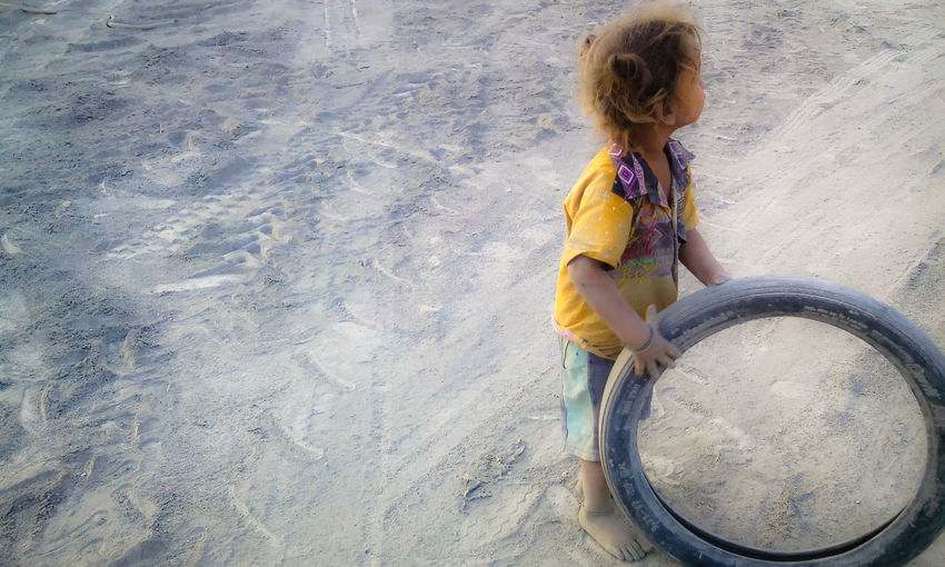 The people who can't afford expensive things, often finds happiness in small things. Just like this boy, who is happy with an old tire,playing and enjoying.Playing Small Boy Dustykid Dusty Tire Playing With Tire Kid Playing Village Life Village Lifestyle Street Photography Enjoying Life Cute Boy Cute Love This Photo Indianstories India Dreams Dreams And Little Things My Favourite Photo Original Experiences Feel The Journey 43 Golden Moments Paint The Town Yellow