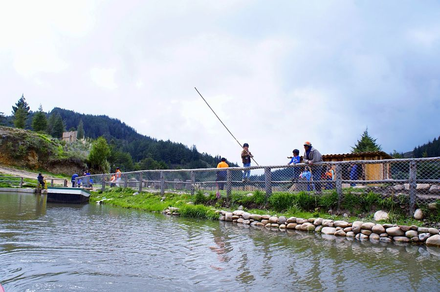 Mini fisherman👶🏻🐟 Real People Men Lifestyles Sky Water Leisure Activity Outdoors Togetherness Nature Beauty In Nature Tourism Peruvian Laviniafenton Beauty In Nature Travel Destinations EyeEmNewHere Trout Farm Trout Tradition Country